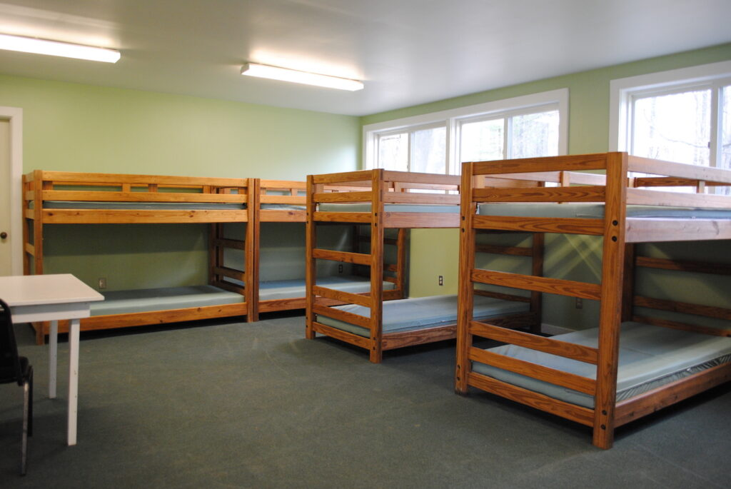 The modern cabin's sleeping quarters with rows of bunkbeds